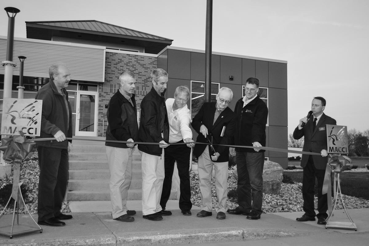 Staabco Executives cutting red tape at the expansion completion