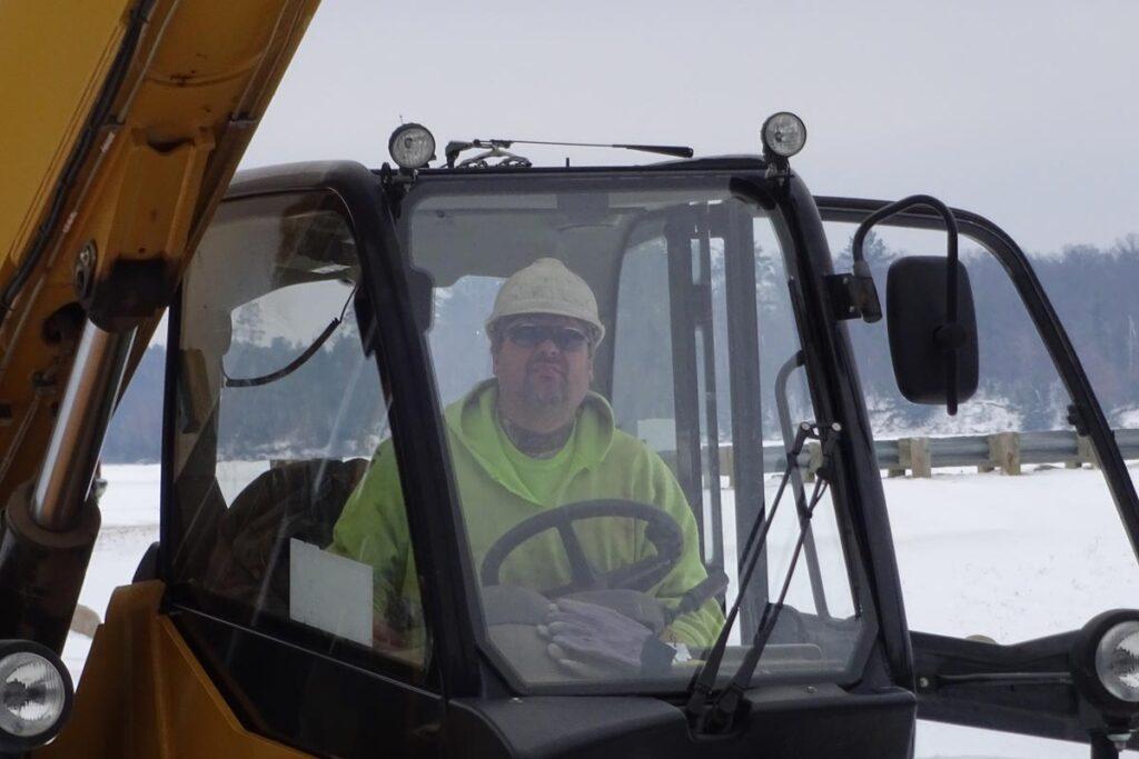 Staab employee in excavator