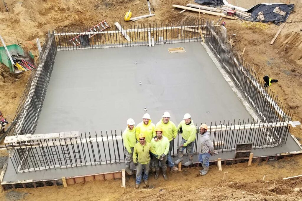 Staab employees smiling at a job site