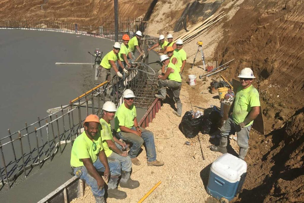 Staabco employees smiling at a job site