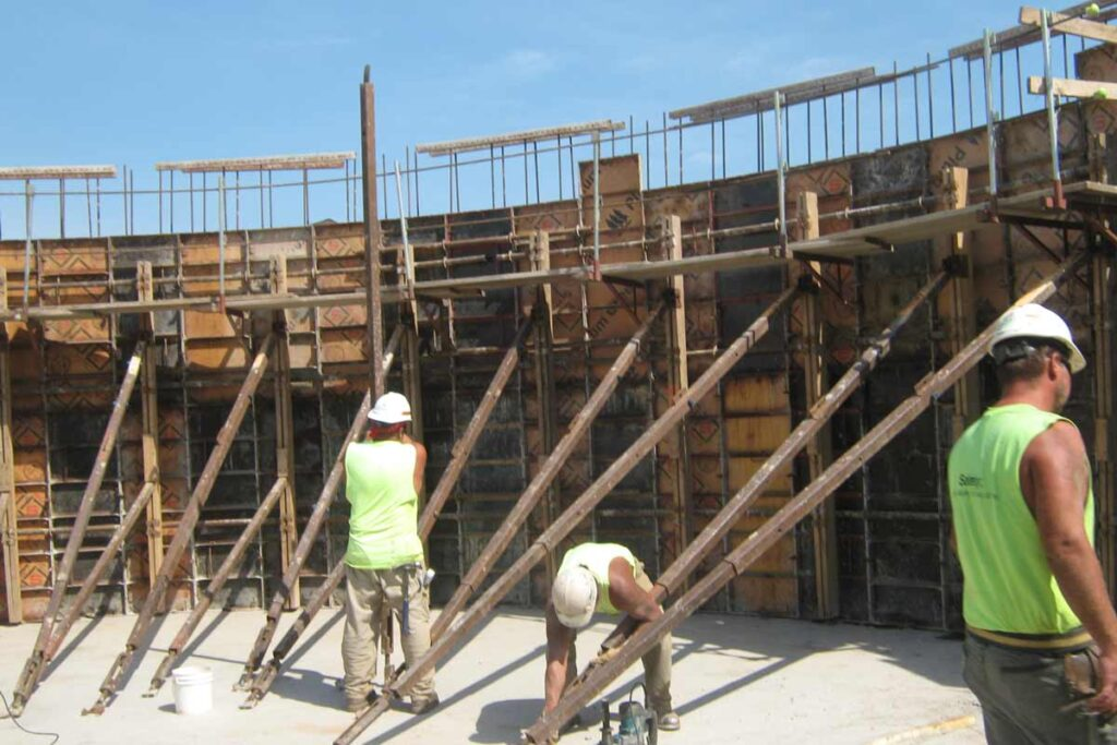 Staabco employees building a wastewater treatment plant