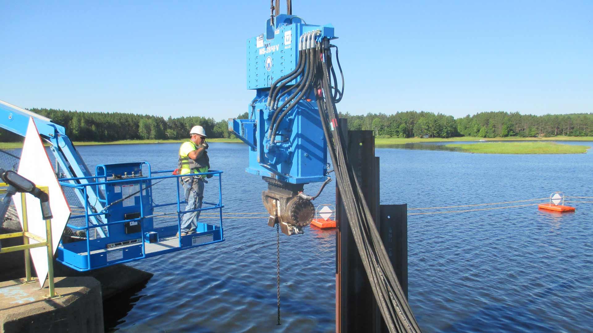 Staab employee working near water