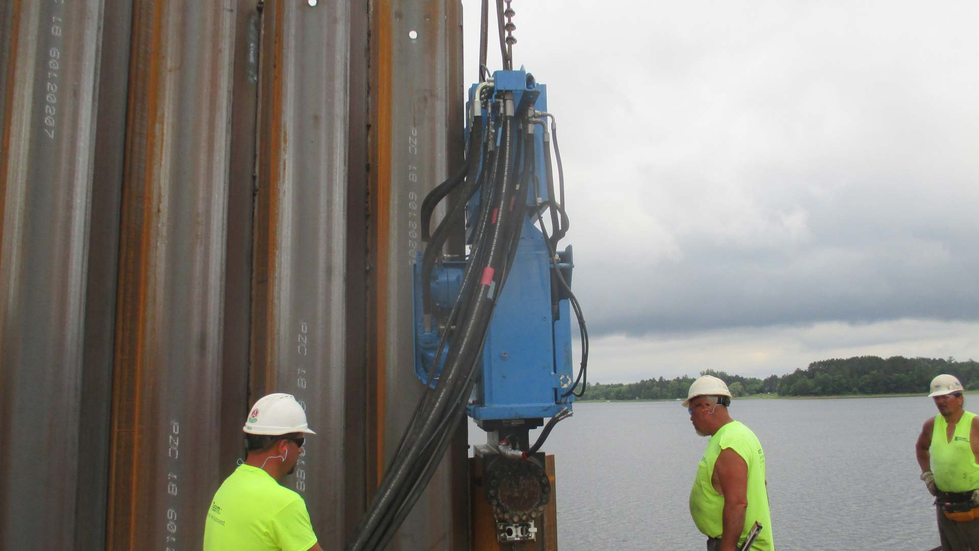 Staab employees working by the water