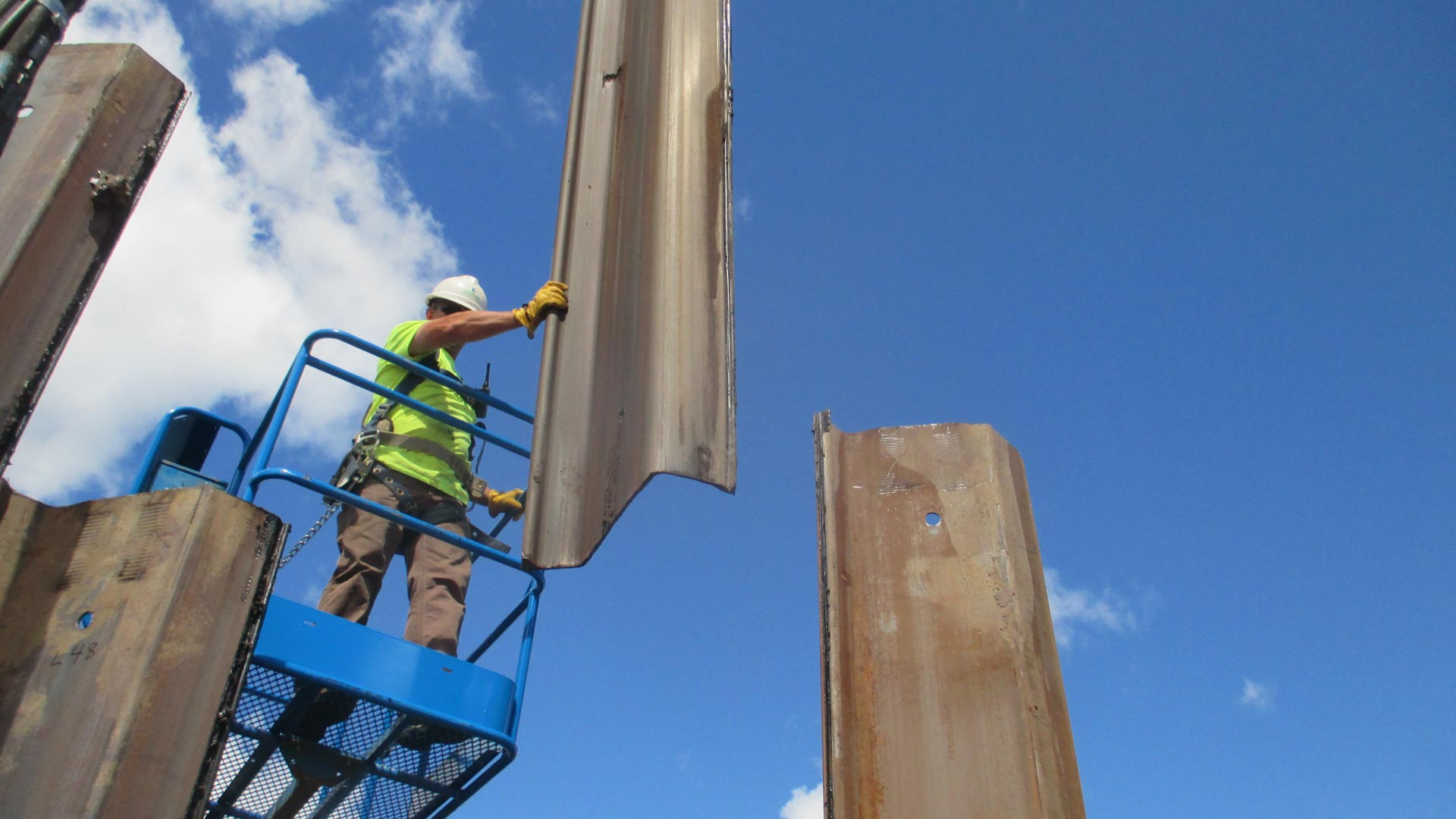 Staab employee holding a metal beam