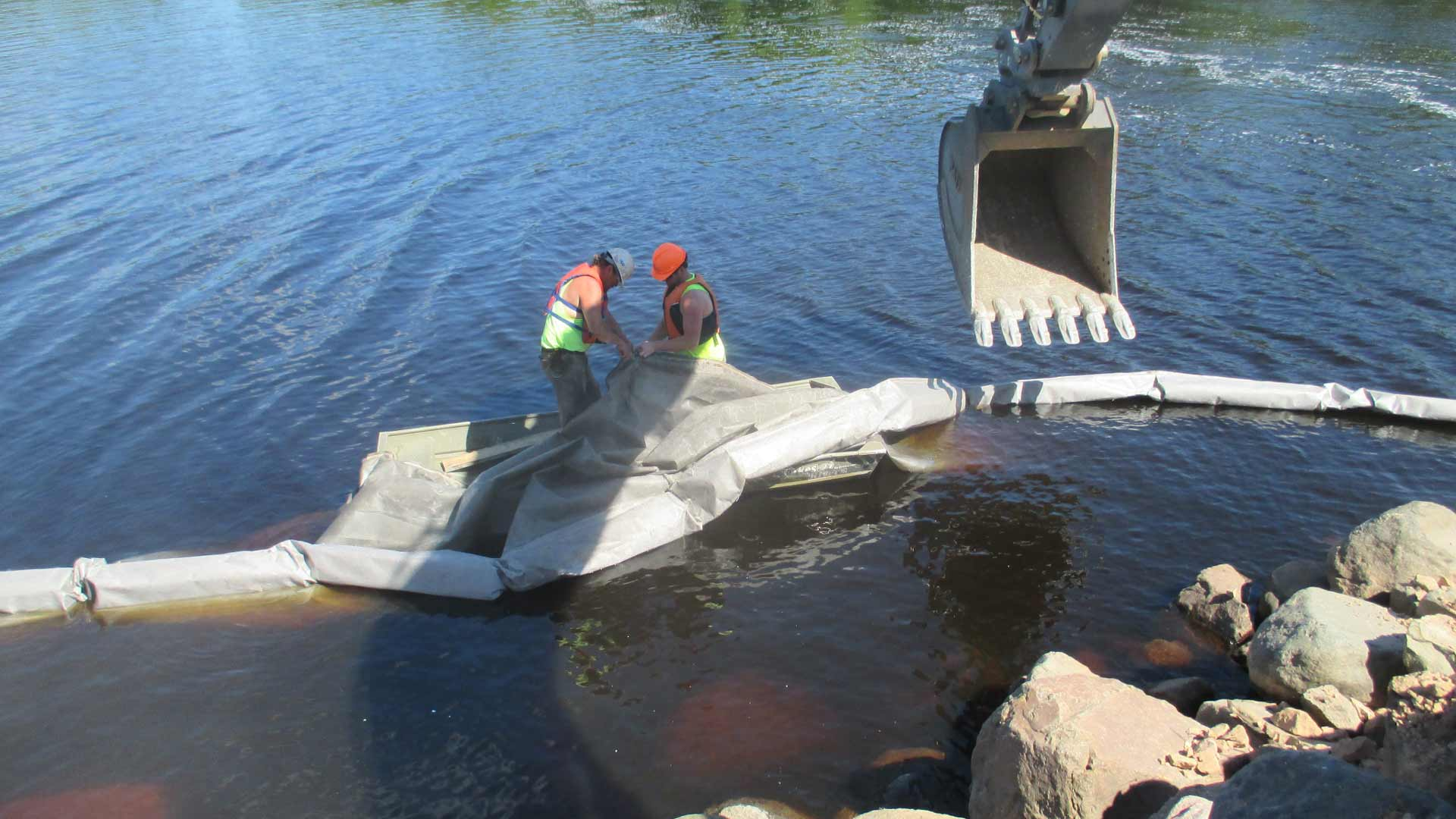 Staab employees working in the water