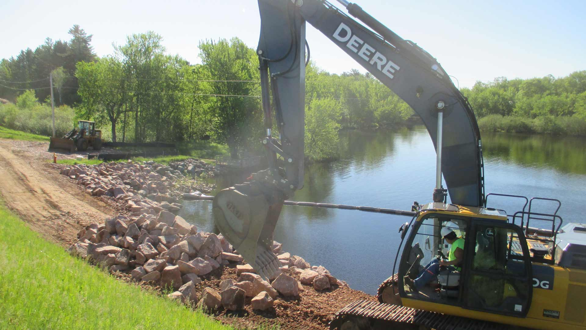 Excavator working by the water