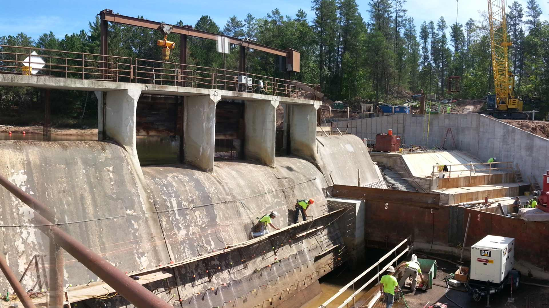 Staab employees working on a dam