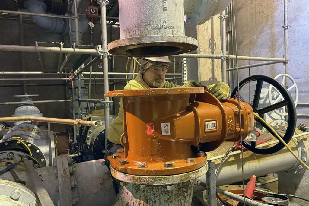 Staab employee working on a mechanical machine