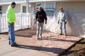 Staab employees working on a patio