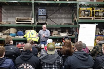 Staab employee giving a presentation to students