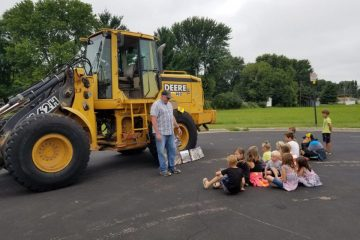 a staab employee talking to a group of kids